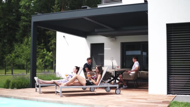 group of friends hanging out by the pool - outdoor chair stock videos & royalty-free footage