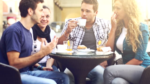 group of friends having an italian breakfast: panning videoclip - social gathering stock videos & royalty-free footage
