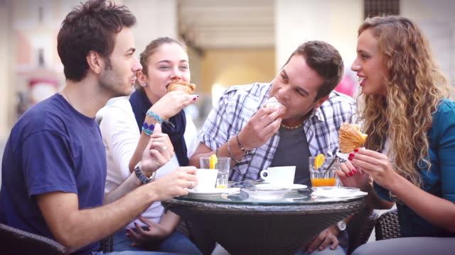 group of friends having an italian breakfast - croissant stock videos & royalty-free footage