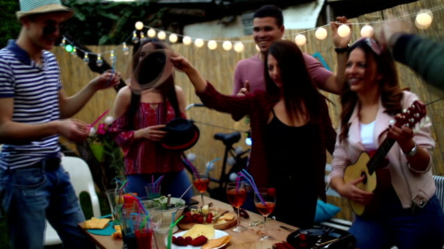 group of friends having dinner party in backyard - celebration event stock videos & royalty-free footage