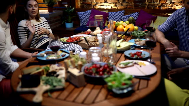group of friends having dinner party outdoors - persona di sangue misto video stock e b–roll