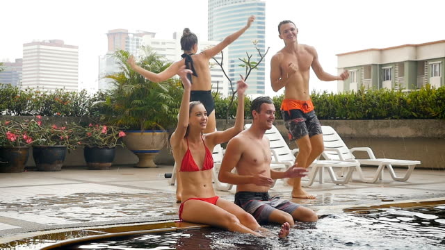 group of friends having fun dancing and playing at swimming pool outdoors, people, vacation and summer concept - swimwear stock videos & royalty-free footage