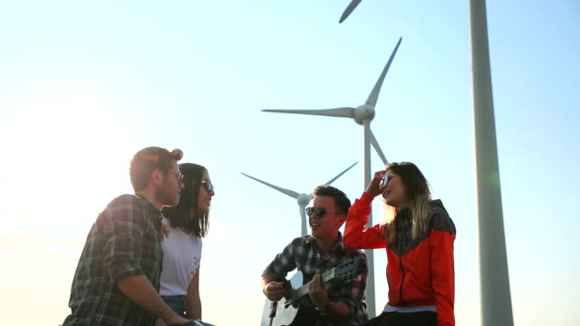 group of friends having fun on wind turbine - old convertible stock videos & royalty-free footage