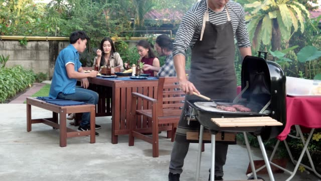 group of friends having outdoor barbeque at home - grilled stock videos & royalty-free footage