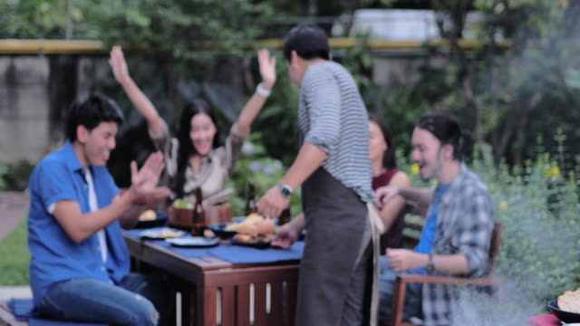 group of friends having outdoor barbeque at home.friends friendship outdoor dining people concept.lifestyle: milestones & celebrations - formal garden party stock videos & royalty-free footage