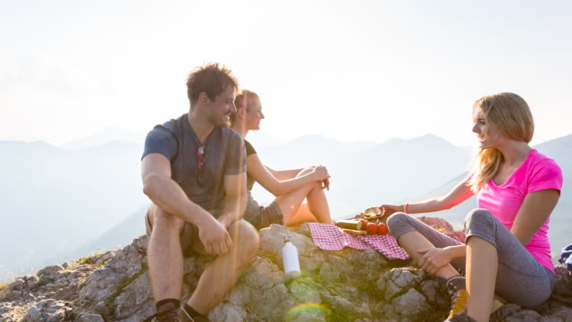 group of friends having picnic on mountain top - picknick stock-videos und b-roll-filmmaterial