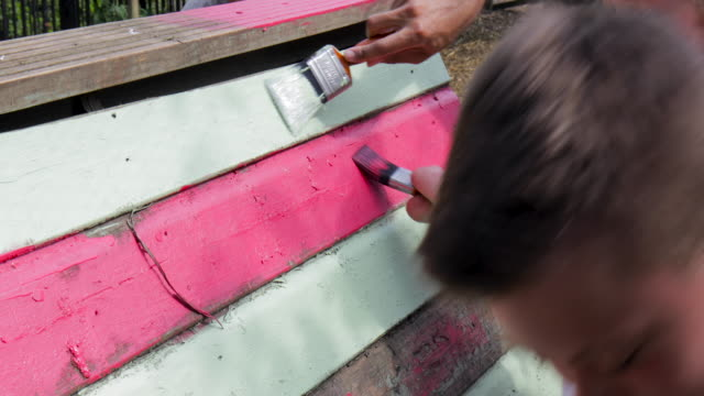 group of friends helping to paint chicken coop - assistance stock videos & royalty-free footage