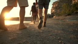Group of friends hiking on rocky coastline