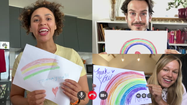 group of friends holding up rainbow drawing to thank healthcare workers during covid-19 pandemic on video call - thank you englischer satz stock-videos und b-roll-filmmaterial