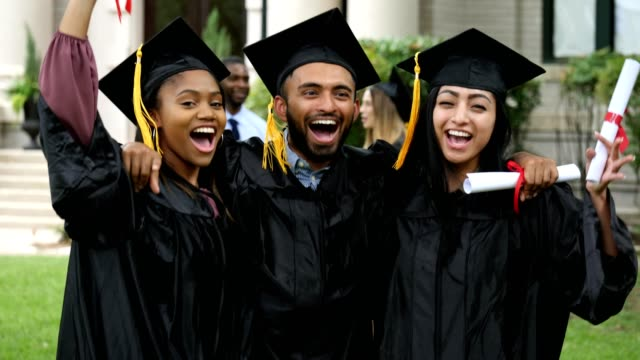 a group of friends jump together and cheer after graduation - mortar board stock videos and b-roll footage