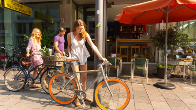 group of friends meeting at cafe with bicycles - parking stock videos & royalty-free footage