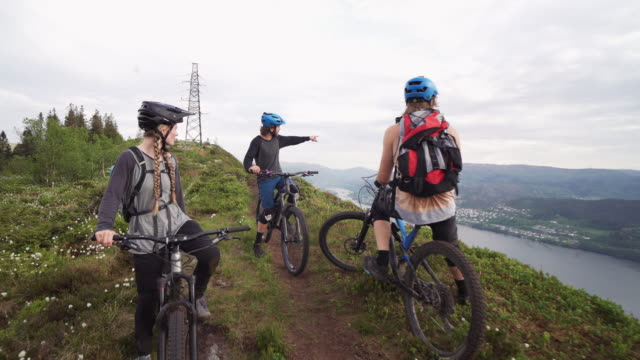 group of friends mountainbike riders: mtb biking outdoor up mountain of norway - biker stock videos & royalty-free footage
