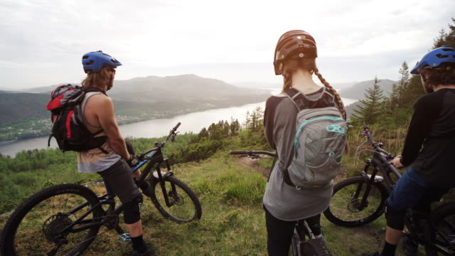 group of friends mountainbike riders: mtb biking outdoor up mountain of norway - outdoor pursuit stock videos & royalty-free footage