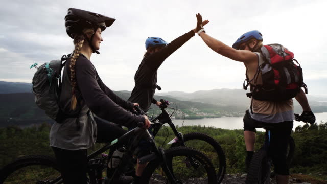 group of friends mountainbike riders: mtb biking outdoor up mountain of norway - motorcycle biker stock videos & royalty-free footage