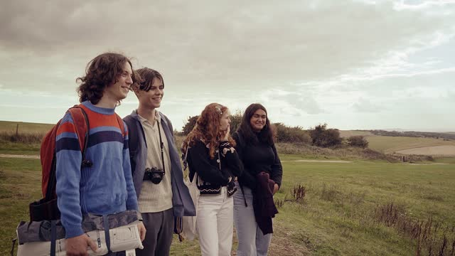 group of friends on a camping trip looking out at the view - east sussex stock videos & royalty-free footage