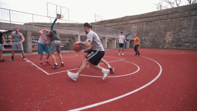 group of friends playing amateur basketball outdoor - shooting baskets stock videos & royalty-free footage