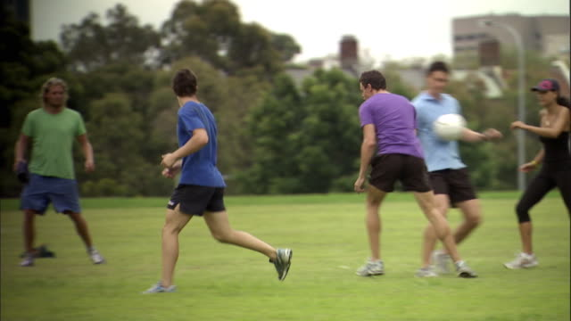 ws, pan, group of friends playing soccer in park, sydney, australia - sporting term stock videos & royalty-free footage