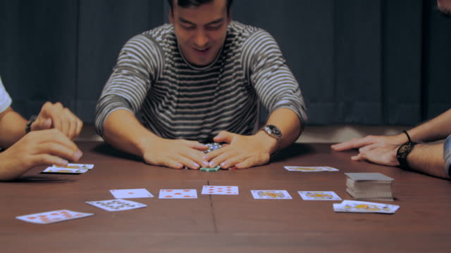group of friends relaxing and playing cards together at home. - poker card game stock videos & royalty-free footage