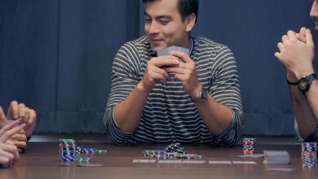 group of friends relaxing and playing cards together at home.leisure, games and lifestyle concept - poker card game stock videos & royalty-free footage