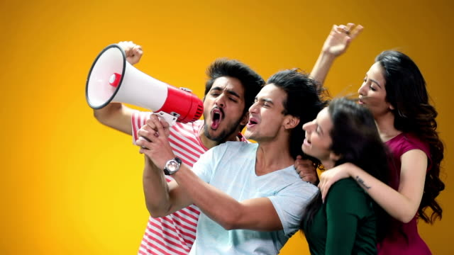Group of friends shouting in a megaphone