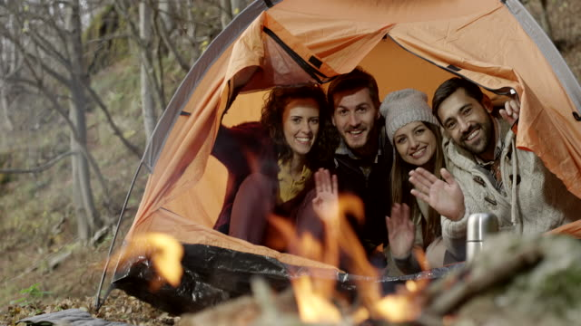 Group of friends sitting in the tent