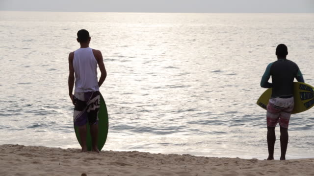 group of friends skimboarding - skimboard stock videos and b-roll footage