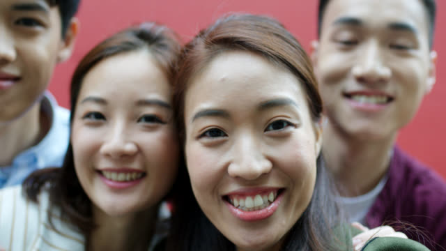 co- group of friends taking a video selfie - china film group stock videos & royalty-free footage