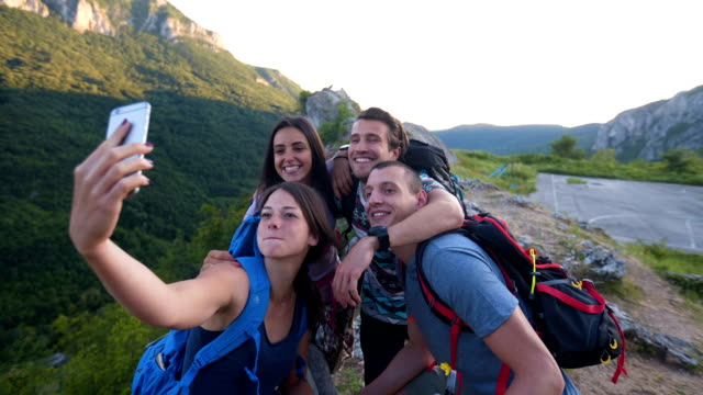group of friends taking selfie at the top of mountain - hiking pole stock videos and b-roll footage