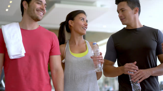 group of friends talking and walking at the gym - bottiglia d'acqua video stock e b–roll