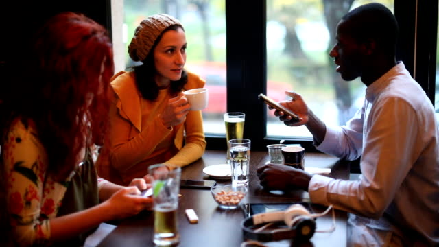 group of friends talking in a cafe - small group of people stock videos & royalty-free footage