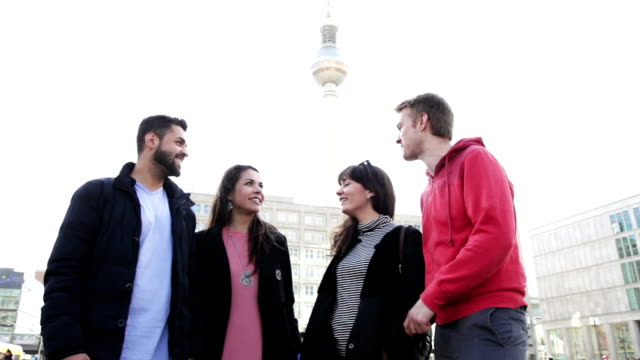 group of friends talking in berlin - alexanderplatz stock videos & royalty-free footage