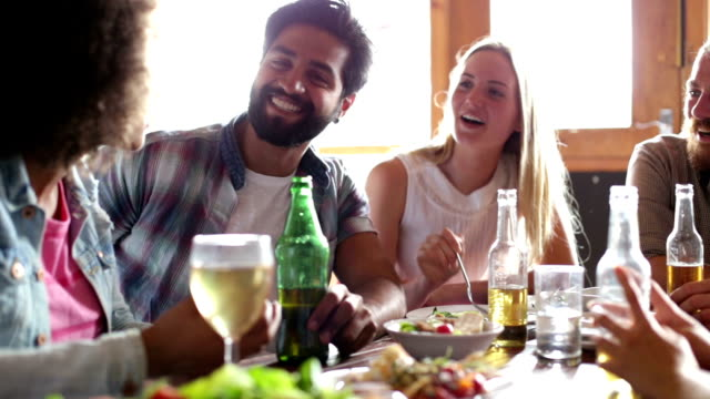 group of friends talking over a meal - food and drink stock videos & royalty-free footage