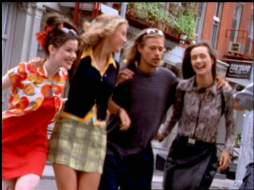 group of friends talking + smiling walking on nyc street - 1997 stock videos & royalty-free footage