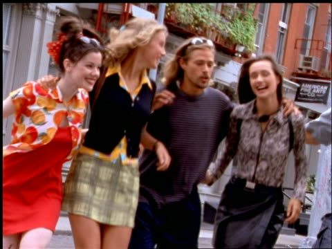 group of friends talking + smiling walking on nyc street - anno 1997 video stock e b–roll