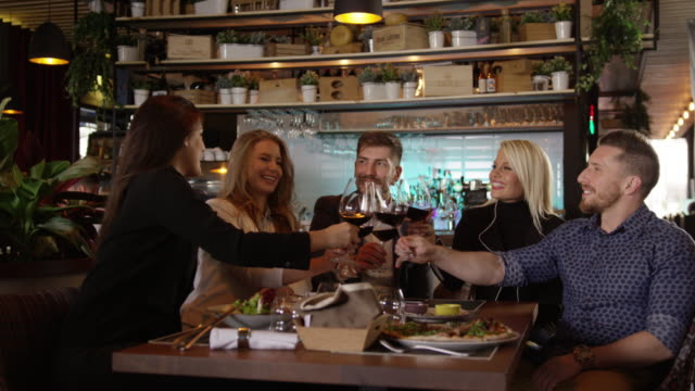 group of friends toasting in the restaurant slow motion 4k - formal stock videos & royalty-free footage