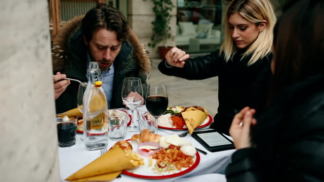 group of friends together having brunch at restaurant - florence italy stock videos & royalty-free footage