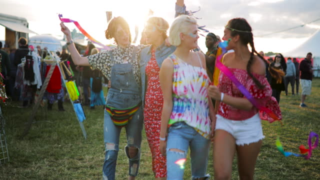 group of friends walking through festival - music festival stock videos & royalty-free footage