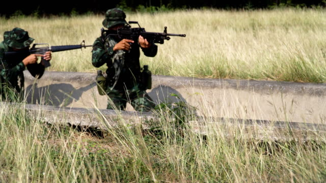 group of fully Equipped and Armed Soldier use drainage to move and patrol