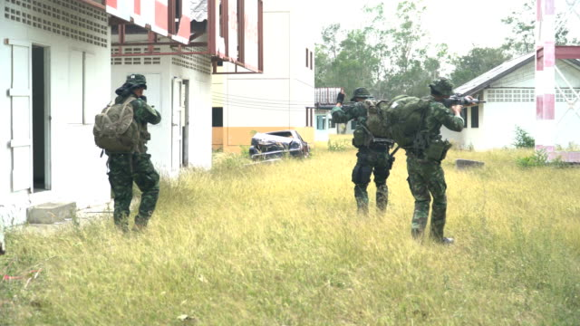 group of fully Equipped and Armed Soldiers  patrol in unknown area and go to inside of house