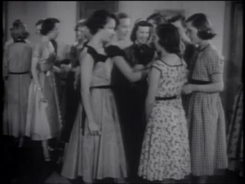stockvideo's en b-roll-footage met b/w 1953 group of girls in dresses standing around + talking at formal dance - alleen tienermeisjes