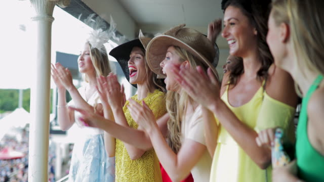group of girls on race day - horse racing stock videos & royalty-free footage