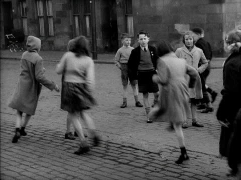 a group of girls play skipping in a street - girls videos stock videos & royalty-free footage