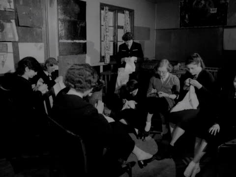 group of girls sew in a youth club hut. 1957. - youth club stock videos & royalty-free footage