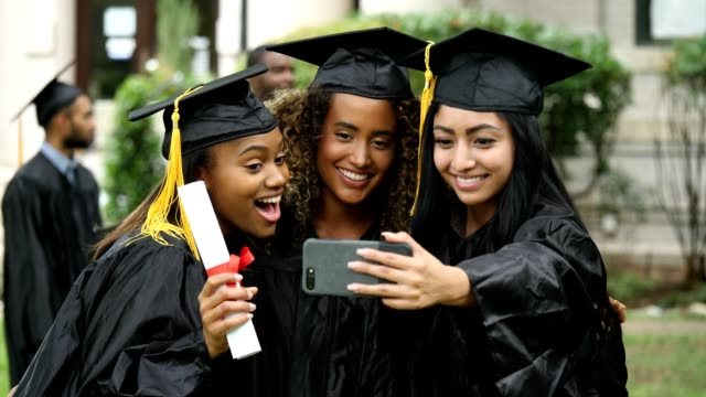 a group of graduating girls take a self-portrait together - diploma stock videos and b-roll footage