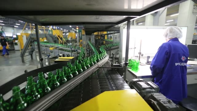 A group of green beer bottles being stacked upon one another at the Ruscam Kirishi OJSC glass manufacturing plant in Kirishi Russia on Monday Feb 1...