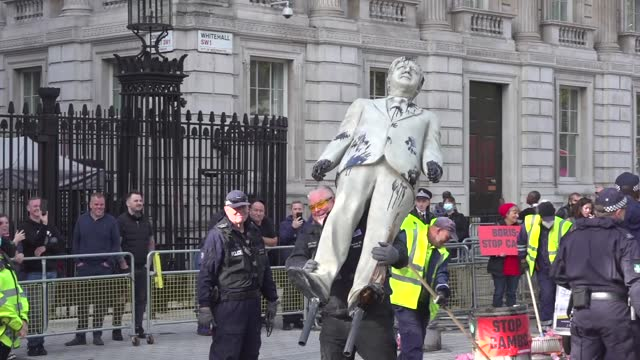 group of greenpeace activists staged a protest in front of downing street on monday, oct. 11. some of the protesters locked their hands in metal... - 10 11 years stock videos & royalty-free footage