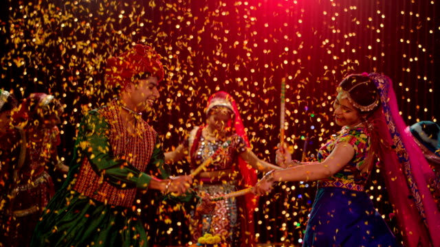 group of gujrati people performing dandiya, delhi, india - religion stock videos & royalty-free footage