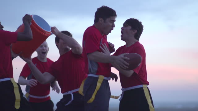 A group of guys playing flag football on the beach. - Super Slow Motion - filmed at 240 fps