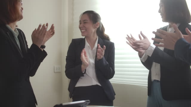 group of happy business people a high five and throw document paper for celebrating for success business, slow motion - standing stock videos & royalty-free footage