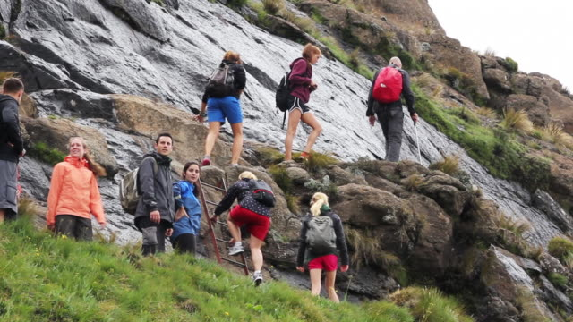 a group of hikers climb a small ladder - drakensberg mountain range stock videos & royalty-free footage